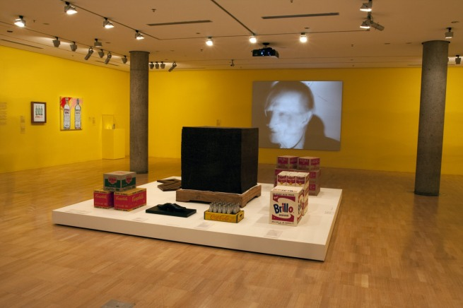 Installation view of the third room including, at centre, Ai Weiwei's 'Tonne of Tea' (2006) and And Warhol's 'Brillo Soap Pads Box' (1964)