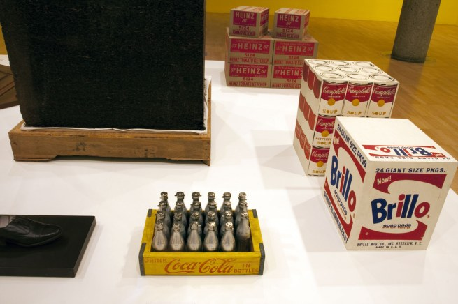 Installation view of the third room including Ai Weiwei's 'Tonne of Tea' (2006) and And Warhol's 'Brillo Soap Pads Box' (1964) and 'You're in' (1967)