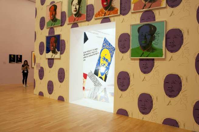 Installation view of part of the fifth room showing Andy Warhol's silkscreen portraits of 'Mao' (1972) hung on his 'Mao Wallpaper' (1974, reprint 2015), on the exterior of Ai Weiwei's 'Letgo room' (2015)