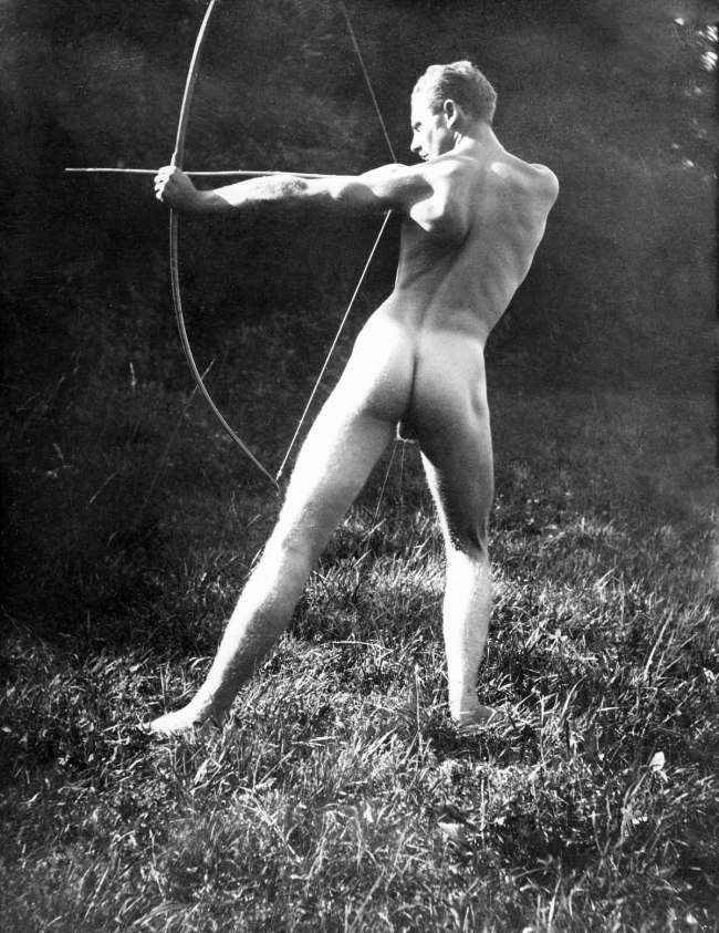Naked archer, member of a nudists' community in Zurich, Switzerland 1910