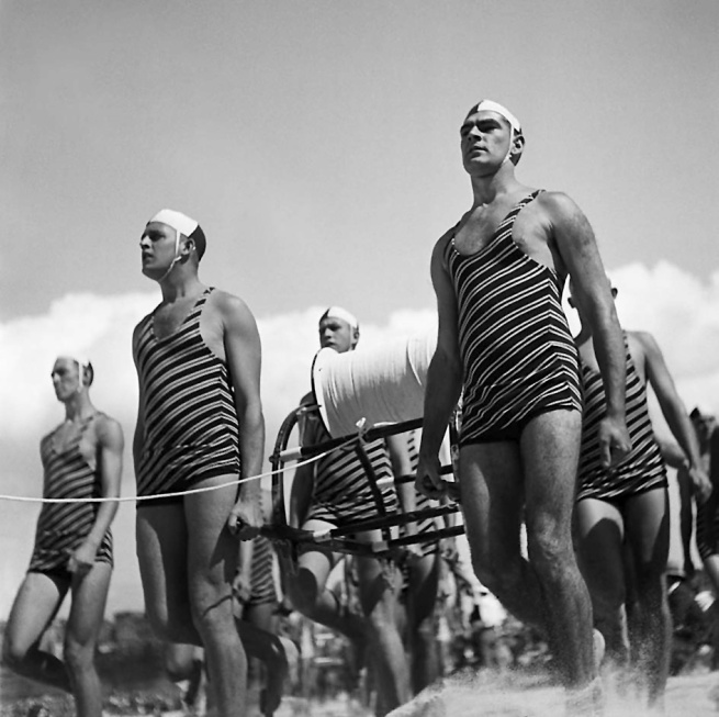 George Caddy (1914-1983) 'Freshwater Surf Life Saving Club reel team march past, 3 April 1938' 1938
