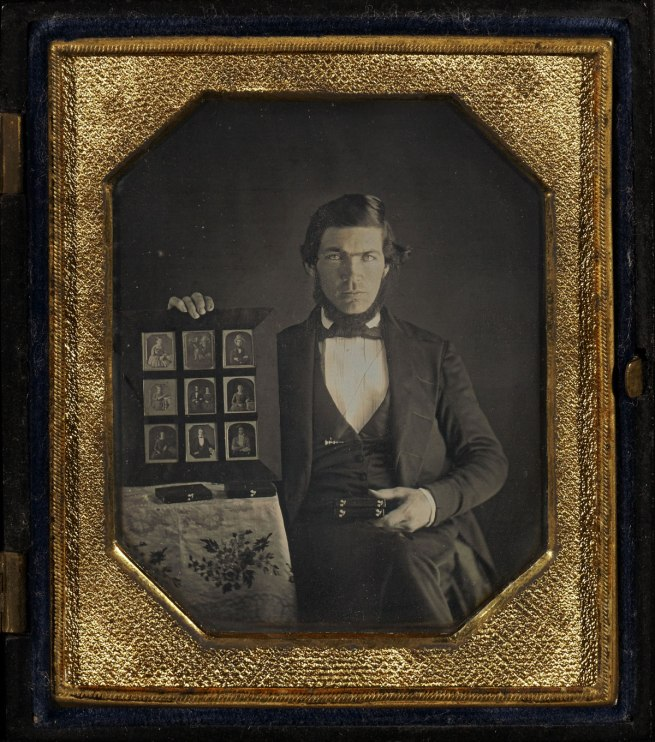 Unknown maker (American) '[Portrait of an Unidentified Daguerreotypist Displaying a Selection of Daguerreotypes] / Daguerreotypist (?) Displaying Thirteen Daguerreotypes' 1845