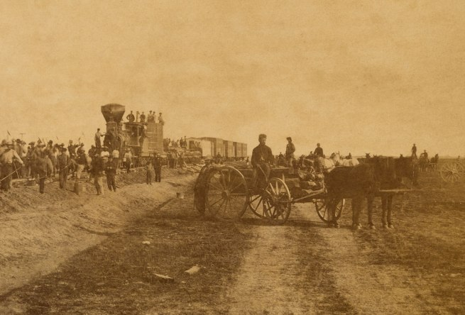 "Alexander Gardner (1821-1882) '""Westward the Course of Empire Takes its Way."" Laying track, 300 miles west of Missouri River, 19th October, 1867' 1867 (detail)"