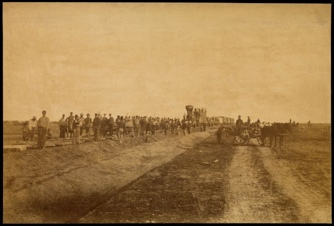 "Alexander Gardner (1821-1882) '""Westward the Course of Empire Takes its Way."" Laying track, 300 miles west of Missouri River, 19th October, 1867' 1867"