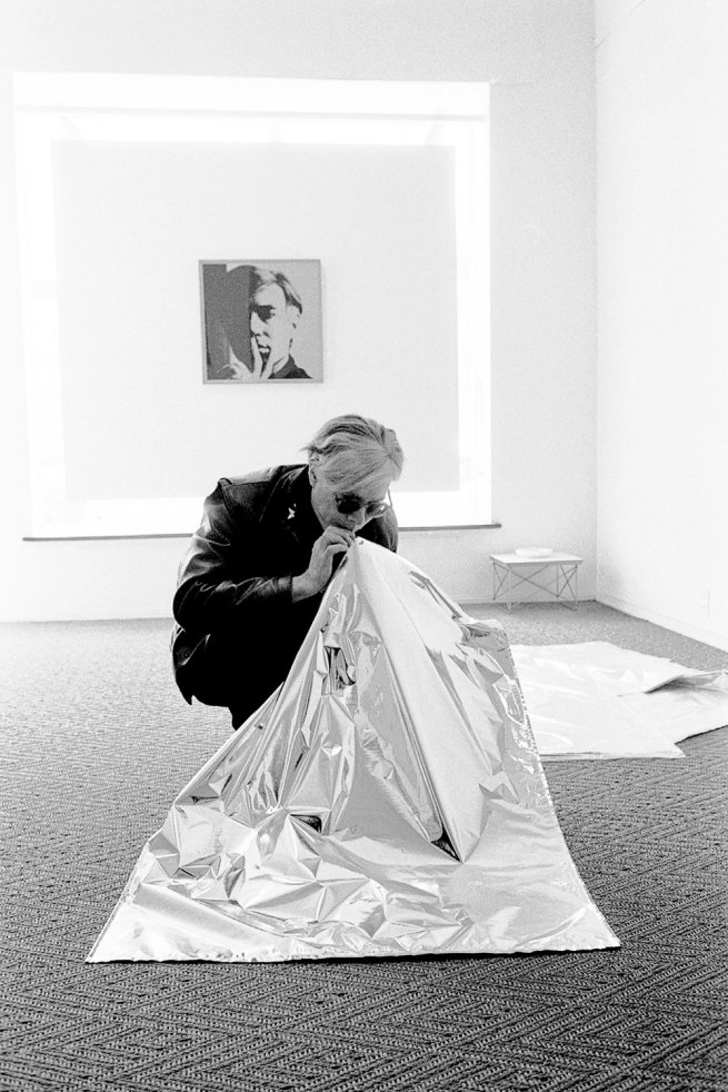 Steve Schapiro. 'Andy Warhol Blowing Up Silver Cloud Pillow, Los Angeles' 1966