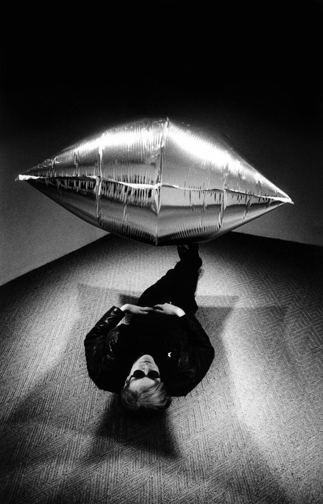 Steve Schapiro. 'Andy Warhol Under the Silver Cloud Pillow, New York' 1965