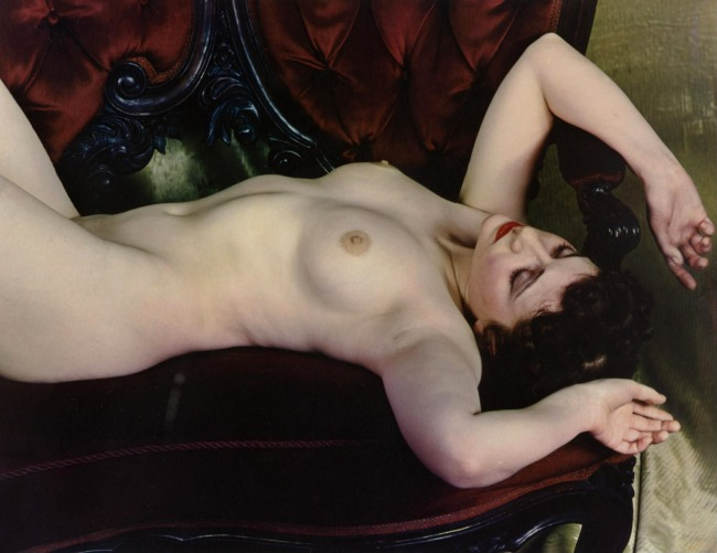 Paul Outerbridge. 'Nude lying on a love seat' c. 1936