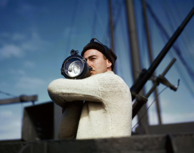 Robert Capa (1913 - 1954) 'A crewman signals another ship of an Allied convoy across the Atlantic from the US to England' 1942