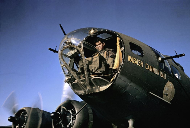 Robert Capa (1913 - 1954) 'An American B-17 gunner awaits take off from a Royal Air Force base for a daylight bombing raid over occupied France' England, 1942