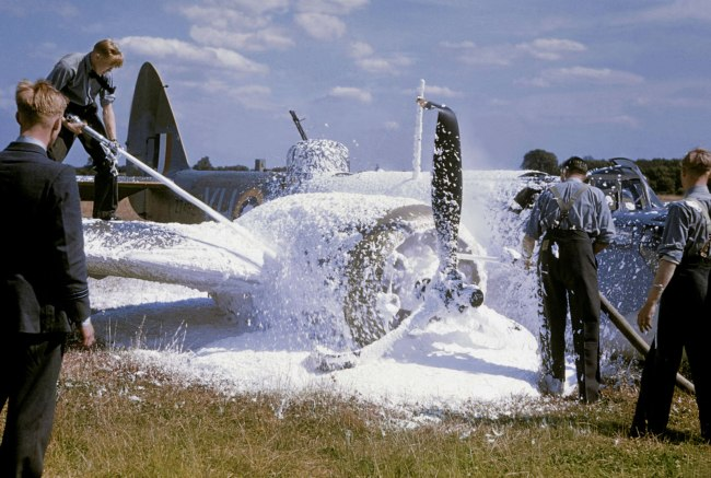 Robert Capa (1913 - 1954) 'Damaged plane hosed down with chemicals after landing on belly following a raid over Occupied France, England, July 1941' 1941