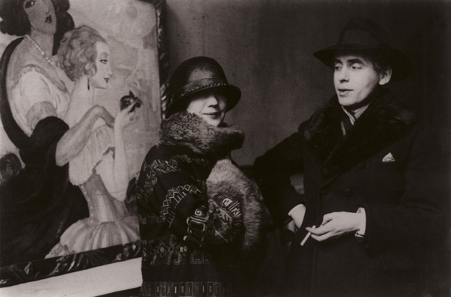 Gerda and Einar Wegener in front of Gerda's painting Sur la route d'Anacapri during the exhibition in Ole Haslunds Hus,1924. Photo The Royal Library, Denmark