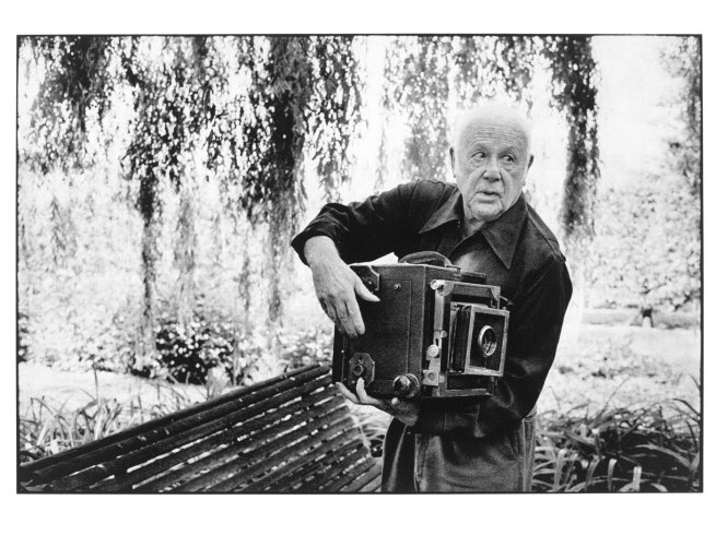 Martine Franck. 'Paul Strand Photographing the Orgeval Garden' 1974