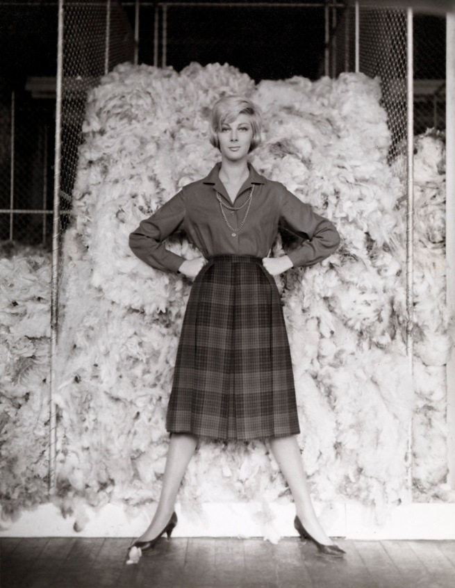 Henry Talbot (Germany 1920 - Australia 1999, Australia from 1940) 'No title (Fashion illustration, model Janice Wakely standing in front of wool bale)' 1961-66