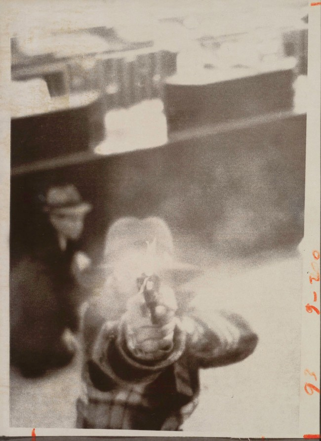 United Press International (American) '[Bank Robber Aiming at Security Camera, Cleveland, Ohio]' March 8, 1975