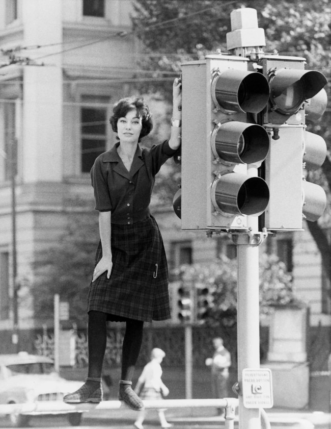 Henry Talbot (Germany 1920 - Australia 1999, Australia from 1940) 'No title (Fashion illustration model wearing plaid kilt style skirt, Spring Street, Melbourne)' 1956-60