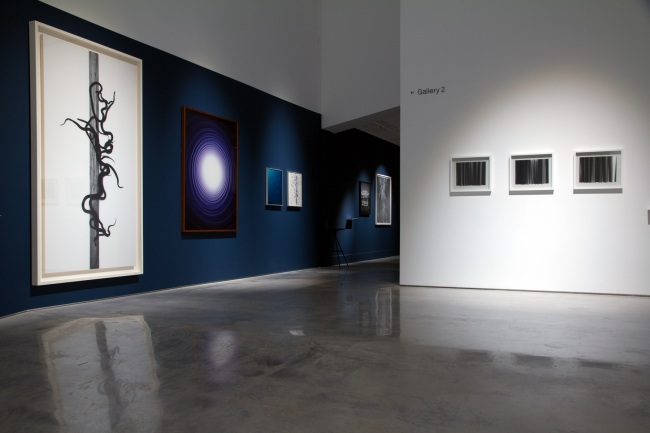 Installation view of the exhibition Emanations: The Art of the Cameraless Photograph at the Govett-Brewster Art Gallery with, at left, Adam Fuss and, at right, Lisa Clunie