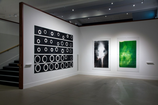 Installation view of Gavin Hipkins (New Zealand) 'The Coil' 1998 (left) and Lucinda Eva-May as part of the exhibition 'Emanations: The Art of the Cameraless Photograph' at the Govett-Brewster Art Gallery