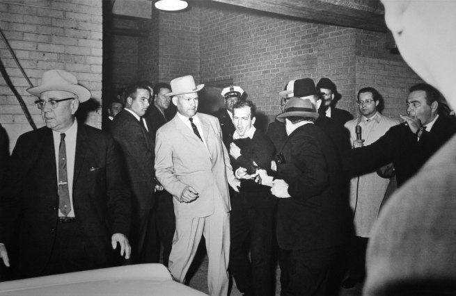 Robert H. Jackson (American, born 1934) 'FATAL BULLET HITS OSWALD. Jack Ruby fires bullet point blank into the body of Lee Harvey Oswald at Dallas Police Station. Oswald grimaces in agony' November 24, 1963