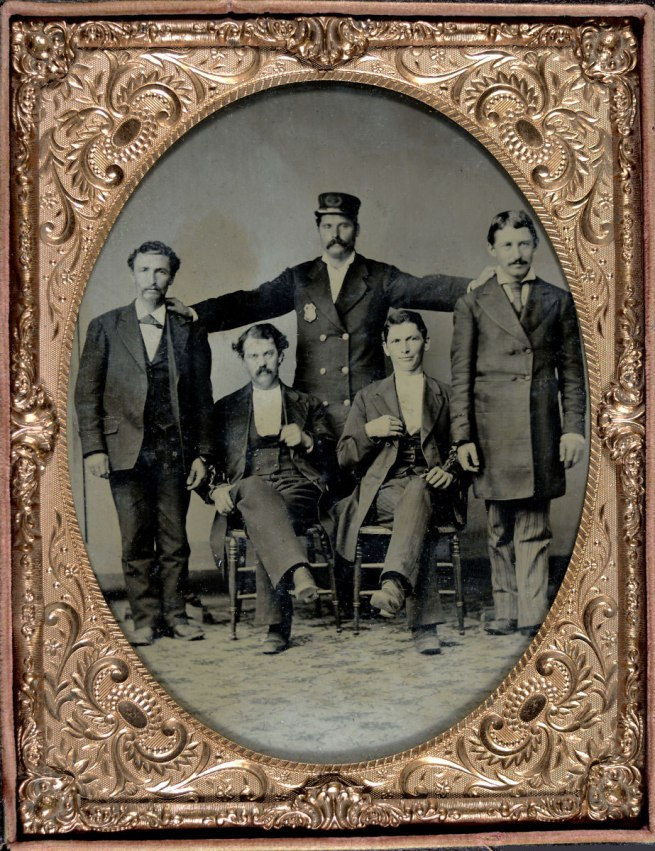"Unknown. 'Policeman Posing with Four ""Collared"" Thugs' c. 1875"