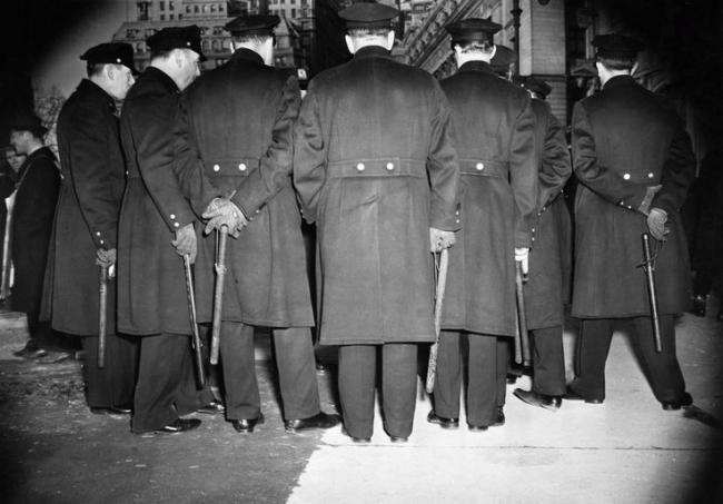 Weegee (American, born Ukraine (Austria), Złoczów (Zolochiv) 1899 - 1968 New York) 'A Bunch of Cops' 1940s