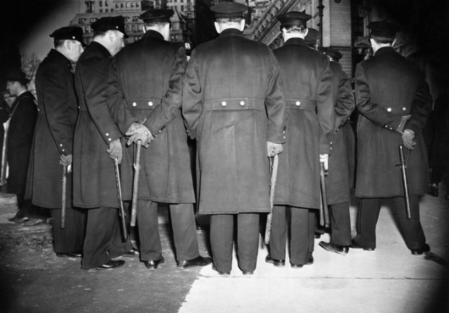 Weegee (American, born Ukraine (Austria), Złoczów (Zolochiv) 1899 - 1968 New York) 'A Bunch of Cops' 1940s