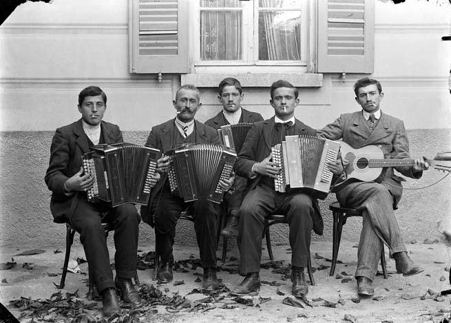 Roberto Donetta. 'Group of musicians in front of a building, Bleniotal' 1900-1932