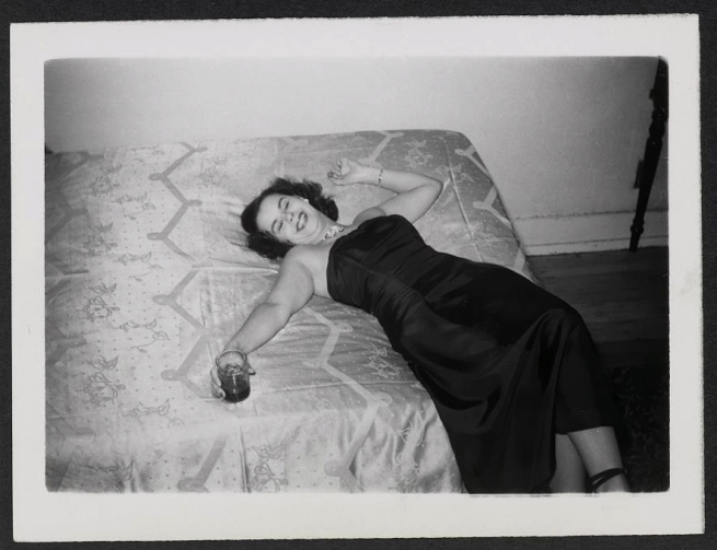 Unknown maker, American. 'Woman with drink on bed' 1950s