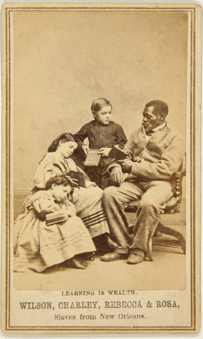 Unknown photographer (American) 'Captioned carte de visite (Learning is Wealth. Wilson, Charley, Rebecca & Rosa, Slaves from New Orleans)' c. 1864