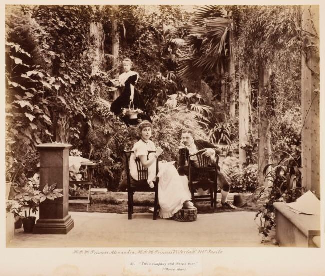 "Unknown photographer. 'H.R.H. Princess Alexandra, H.R.H. Princess Victoria & Mr. Savile, ""Two's company and three's none"" in Tableaux Vivants Devonport' c. 1892-1893"