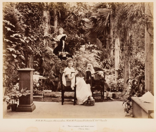 "Unknown photographer. 'H.R.H. Princess Alexandra, H.R.H. Princess Victoria & Mr. Savile, ""Two's company and three's none"" in Tableaux Vivants Devonport' c. 1892-1893"