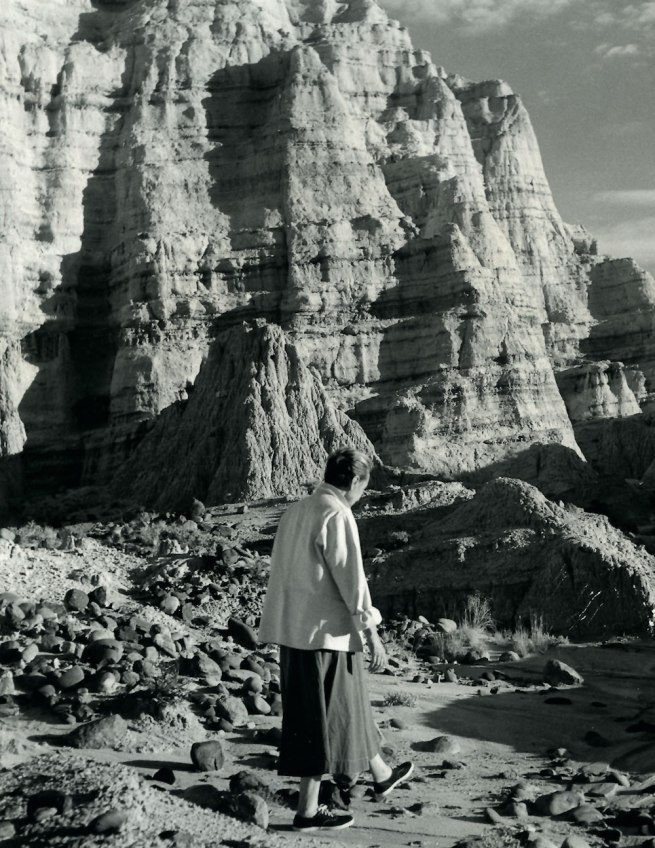Todd Webb. 'Georgia O'Keeffe walking at the White Place, New Mexico, 1957' 1957