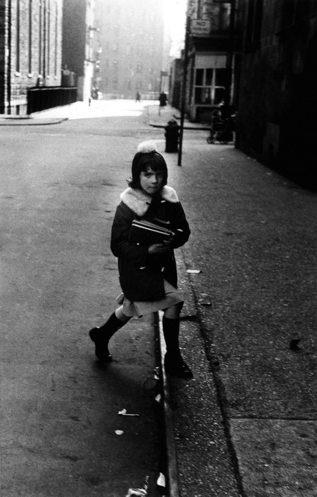 Diane Arbus (1923-1971) 'Girl with schoolbooks stepping onto the curb, N.Y.C., 1957' 1957