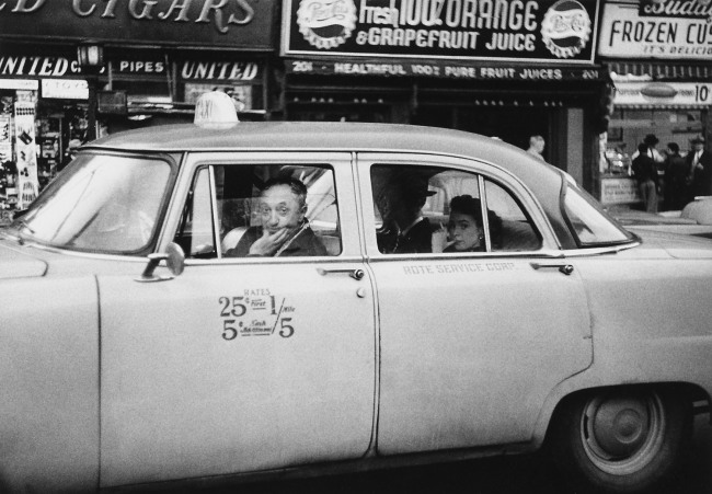Diane Arbus. 'Taxicab driver at the wheel with two passengers, N.Y.C. 1956' 1956