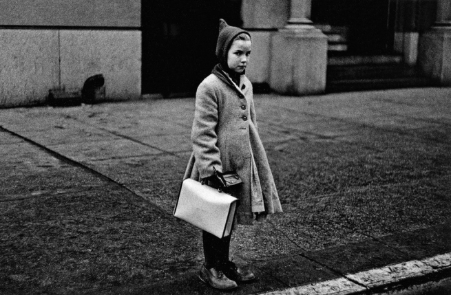 Diane Arbus (1923-1971) 'Girl with a pointy hood and white schoolbag at the curb, N.Y.C. 1957' 1957