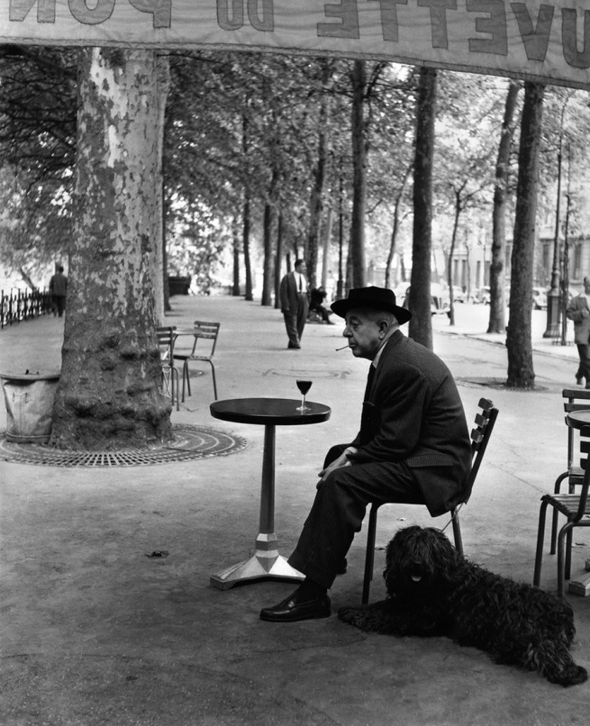 Robert Doisneau. 'Jacques Prevert au guéridon' (Jacques Prevert and table) 1955