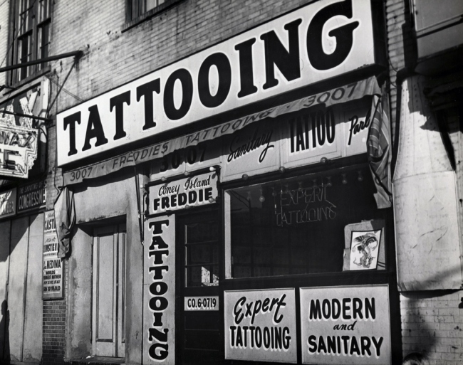 """Irving Herzberg (1915-1992) 'Tattoo shop of """"Coney Island Freddie"""" just prior to New York City's ban on tattooing' 1961"""