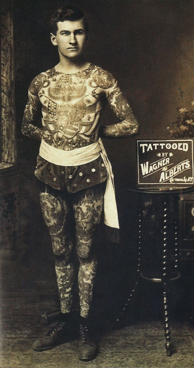 "Unknown photographer. '""Painless"" Jack Tyron tattooed by Charlie Wagner and Lewis (Lew) Alberts' Nd"
