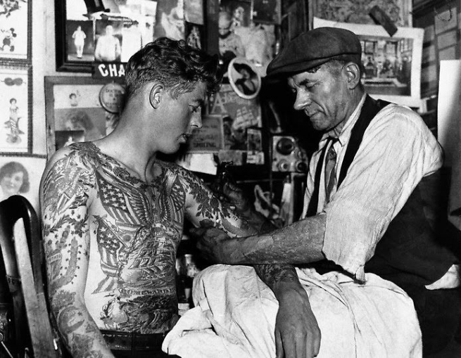 Unknown photographer. 'Untitled [Charlie Wagner tattooing in his studio]' Nd