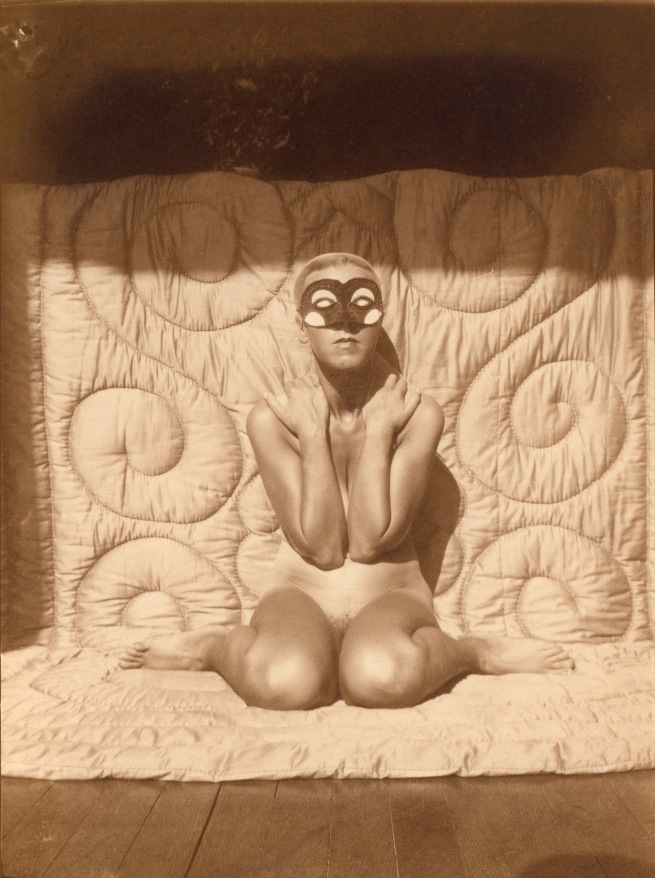 Claude Cahun. 'Self-portrait (kneeling, naked, with mask)' c. 1928