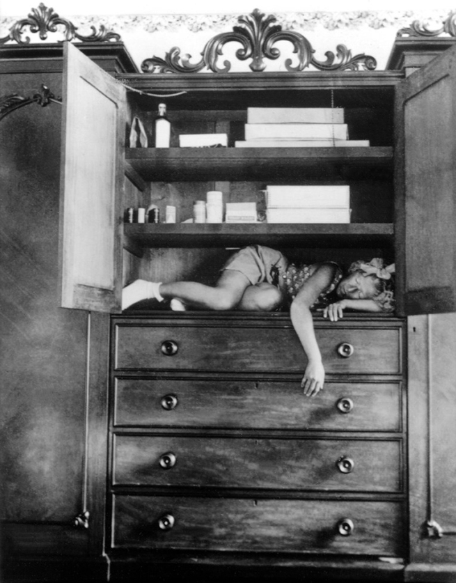 Claude Cahun. 'Self-portrait (in cupboard)' c. 1932