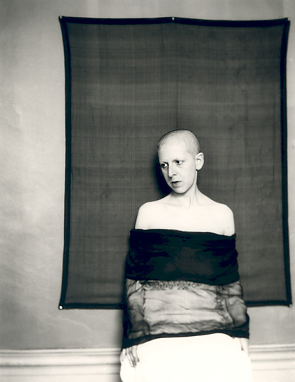 Claude Cahun. 'Self-portrait (shaved head, material draped across body)' 1920