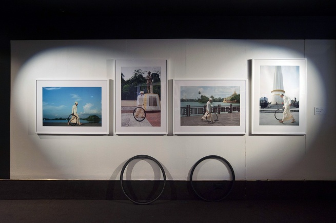 Installation view of Moe Satt's 'The Bicycle-Tyre-Rolling Event from Yangon' (2013)