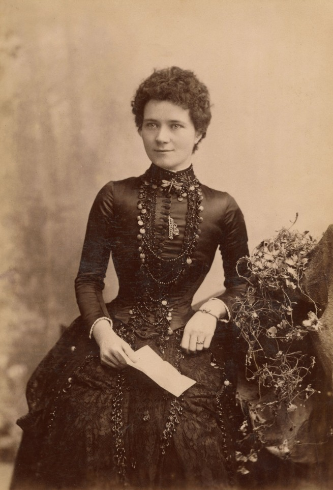 Tuttle. 'Lady in a heavily beaded bodice and skirt' 1885-1894