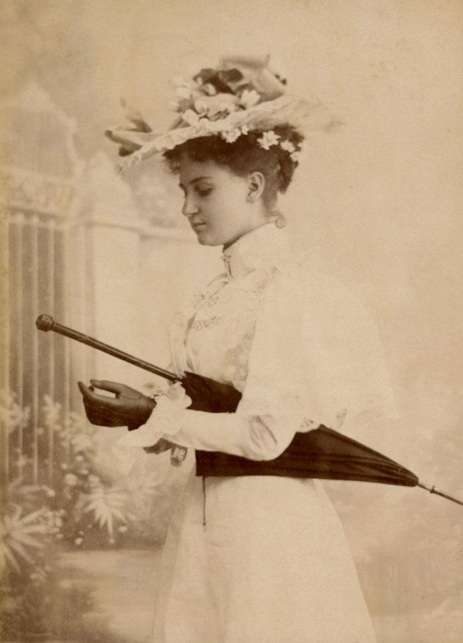 Dana Studio. 'Lady wearing gloves with parasol' 1897-1898
