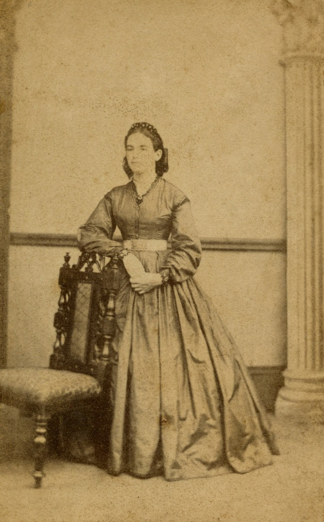 Daniel Marquis. 'The same woman in a crinoline dress posing with a chair' 1865-1870