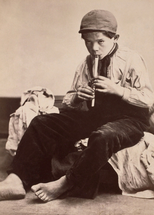 Oscar Gustave Rejlander. 'No title (Shoeless boy playing whistle)' c. 1860