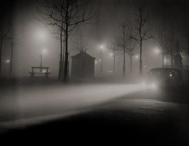 Brassaï. 'Avenue de l'Observatoire, phares de voiture' 1934