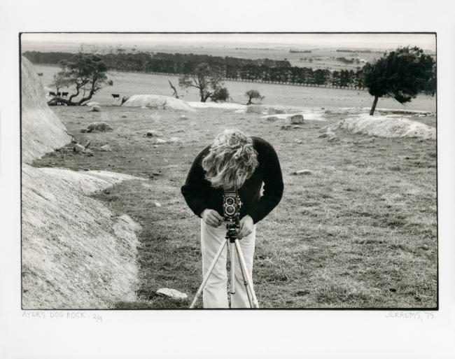 Carol Jerrems. 'Ayer's Dog Rock [Bill Heimerman looking through his Rolleiflex]' 1975