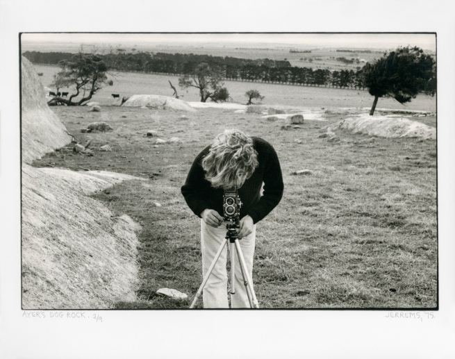 Carol Jerrems. 'Ayer's Dog Rock [Bill Heimerman looking through his Rolleiflex]' 1975