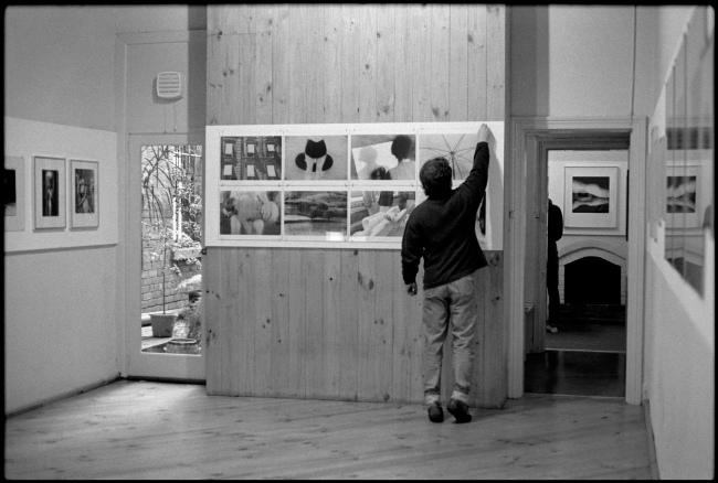Louise Bradley. Untitled [William Heimerman adjusting Robert Besanko prints in the main space of the Photographers' Gallery] c. 1975-80